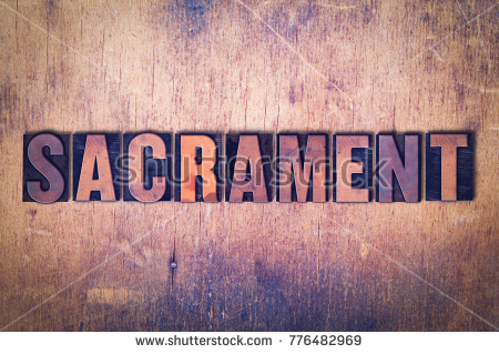 stock-photo-the-word-sacrament-concept-and-theme-written-in-vintage-wooden-letterpress-type-on-a-grunge-776482969
